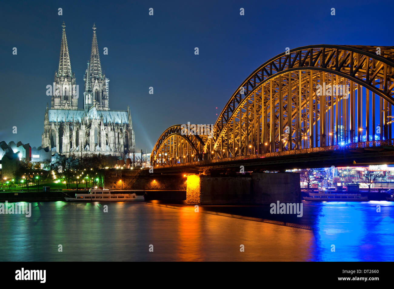 Cologne Cathedral, The Hohenzollern Bridge and River Rhine at Night, Cologne, Germany, Europe. - Stock Image