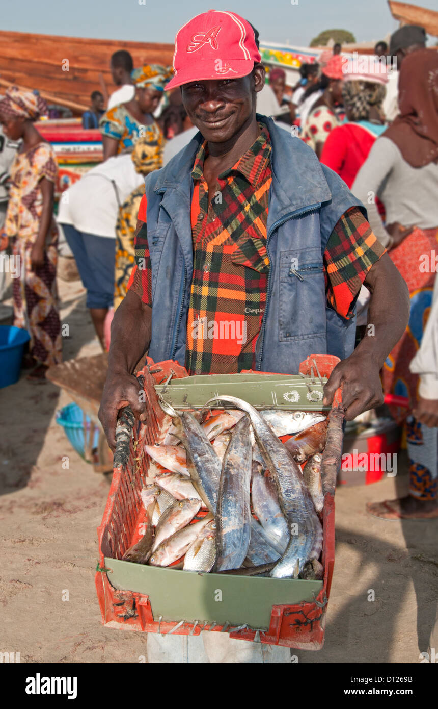 Local Fisherman Displaying his Catch, Tanji Fishing Village, The Gambia, West Africa - Stock Image