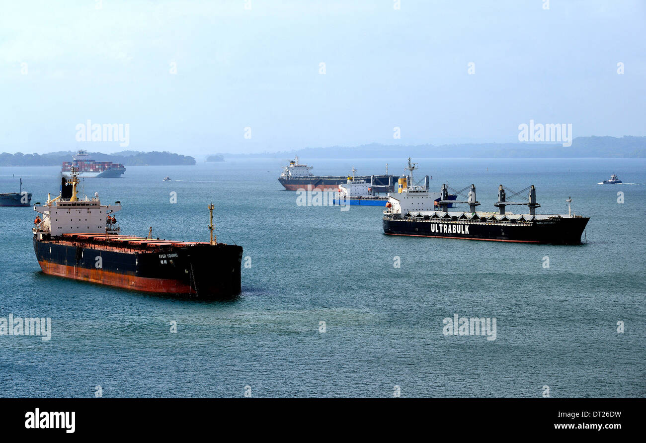 Ever Young Ultra Initiator and other ships waiting on Gatun lake for entering in Gatun locks Panama canal - Stock Image