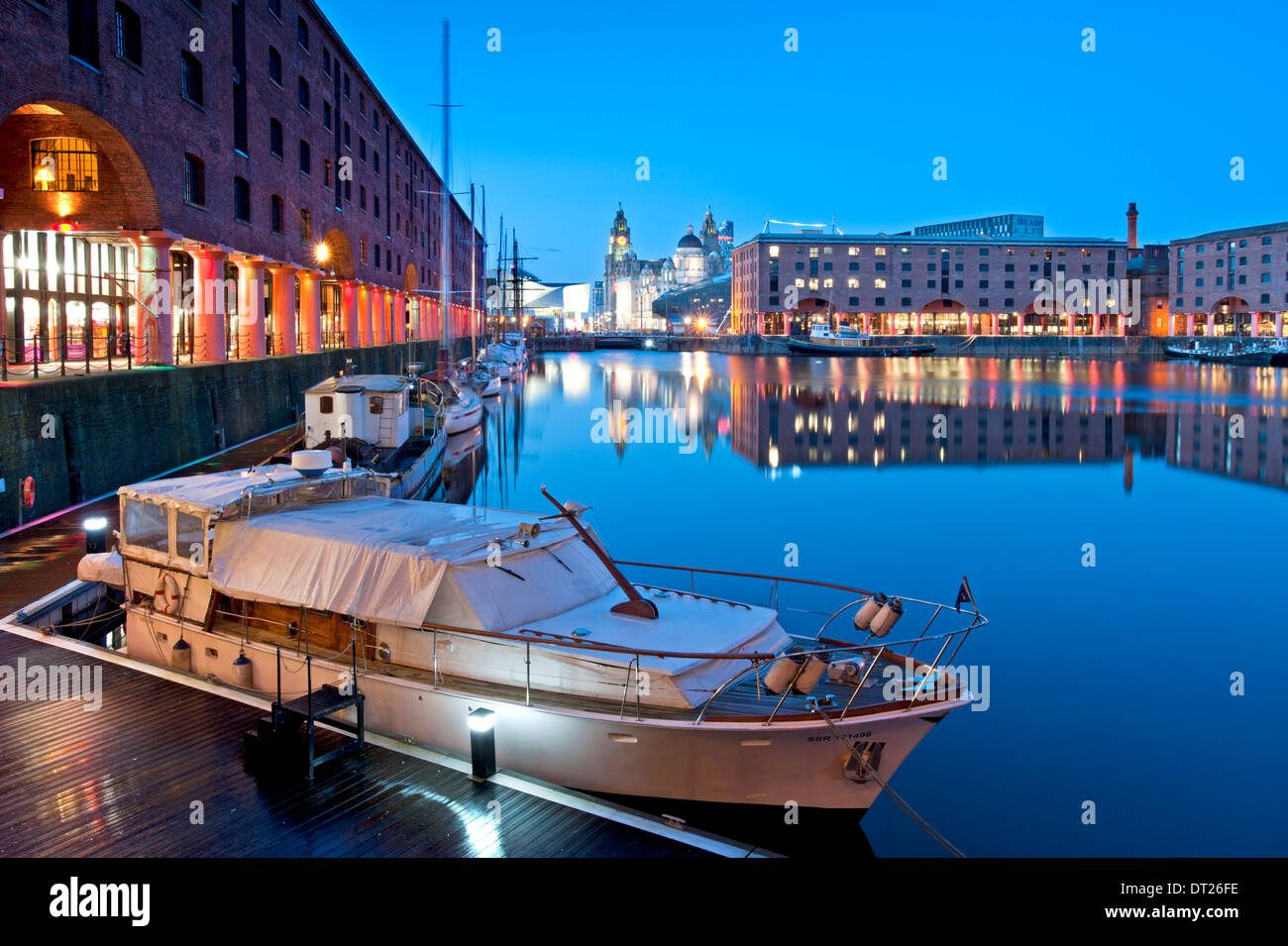 The Albert Dock at Night, with the Liver Building behind, Liverpool, Merseyside, England, UK - Stock Image