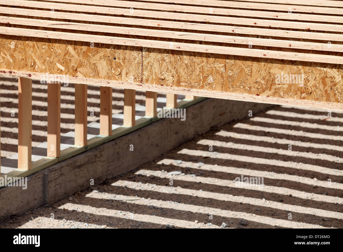 The repeating pattern of floor joists in a new construction project - Stock Image