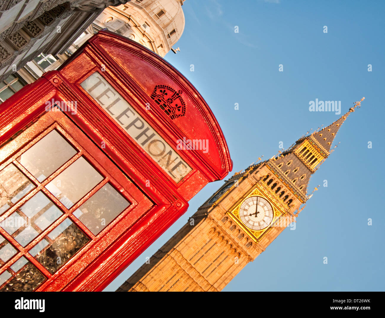 British Bright Red Telephone Box and Big Ben, London, England, UK - Stock Image