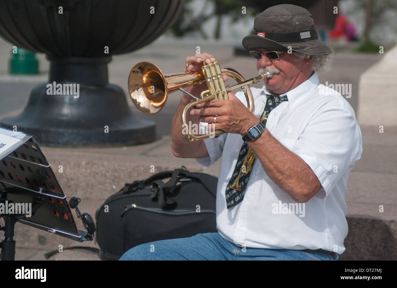 street musician playing trumpet  Quebec - Stock Image