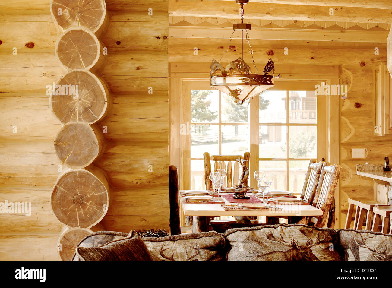 The great room in a modern log cabin, with rustic decor, and furniture. - Stock Image