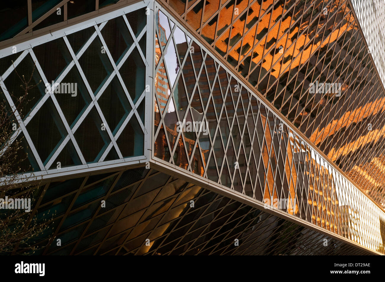 WASHINGTON - Detail view of the downtown Seattle Public Library with glass panels reflecting neighboring buildings. - Stock Image