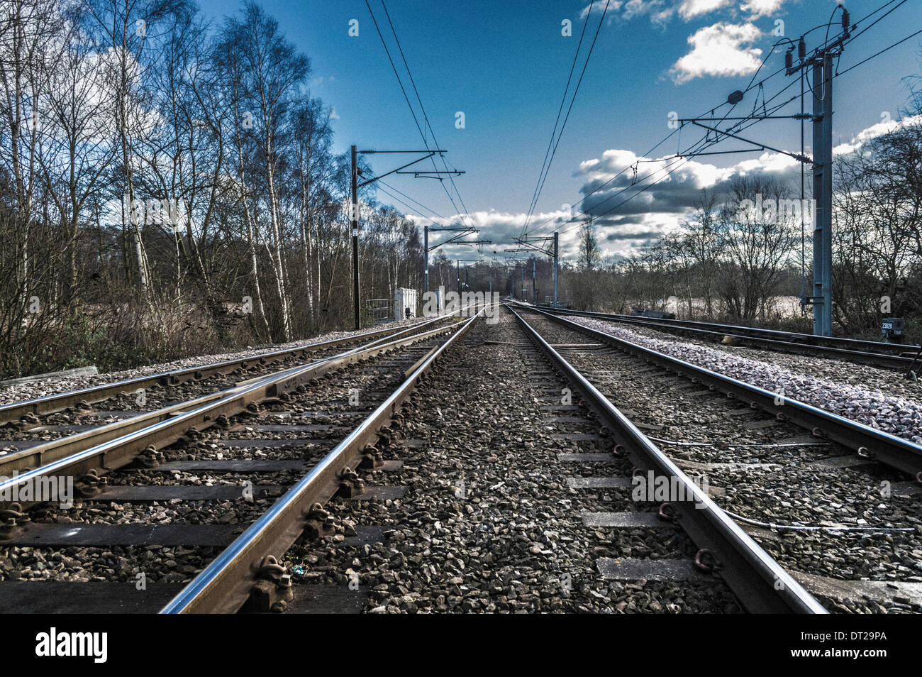railway tracks disappearing into distance - Stock Image