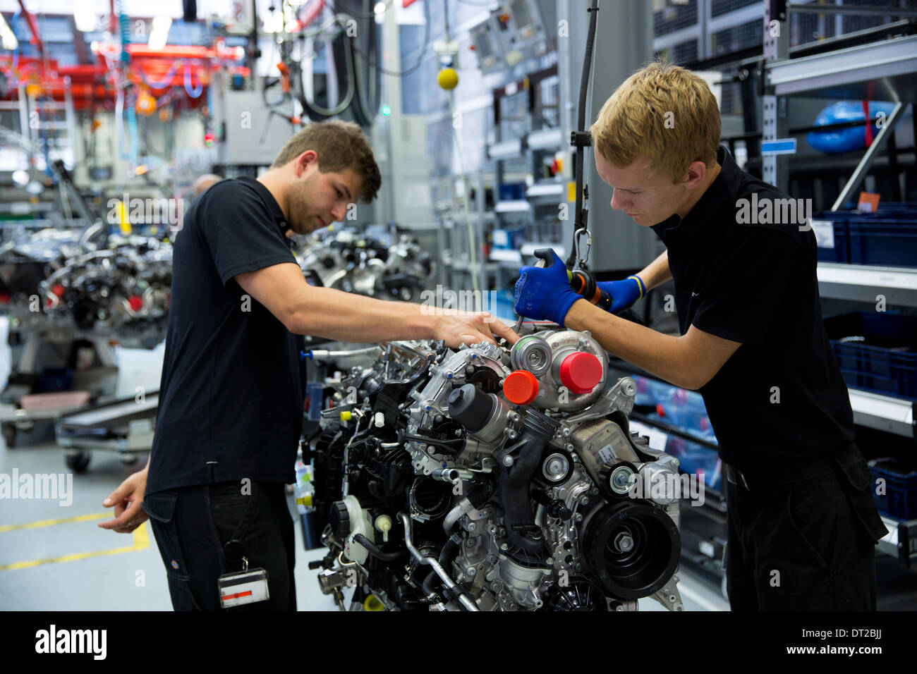 Mercedes-AMG engine production factory Germany - trainee engineer supervised hand-building M157 5.5L V8 biturbo engine, Germany - Stock Image