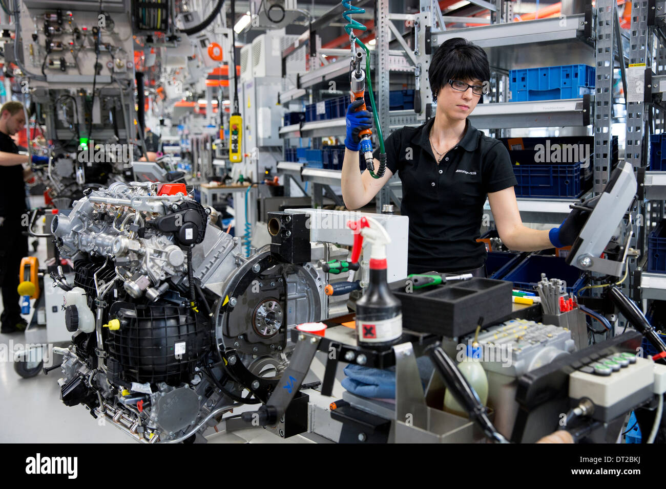 Mercedes-AMG engine production factory in Affalterbach, Germany - female engineer hand-builds a M157 5.5L V8 biturbo engine - Stock Image