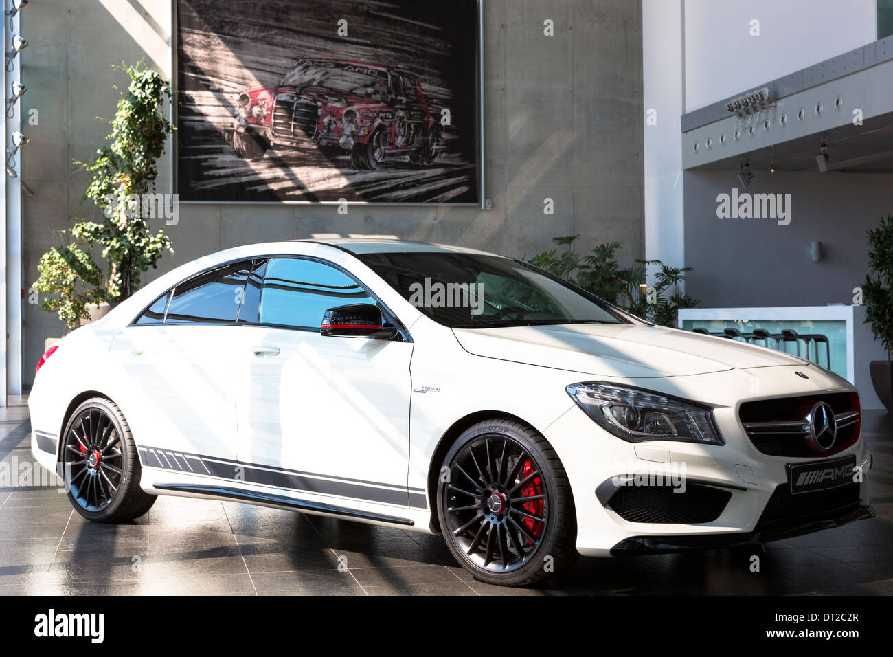 Mercedes-AMG CLA 45 AMG with latest 4 cylinder engine and ceramic brakes in showroom at engine factory, Affalterbach, Germany - Stock Image
