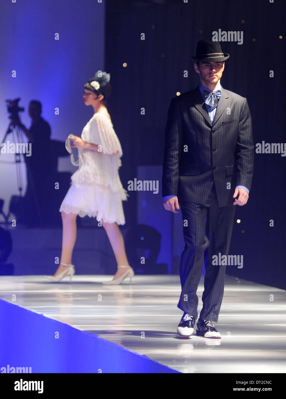 Jakarta, Indonesia . 06th Feb, 2014.  Models present creations by designer Adjie Notonegoro at 'The 1920's Public Enemies' fashion show in Jakarta, Indonesia, Feb, 6. 2014. Credit:  Xinhua/Alamy Live News - Stock Image