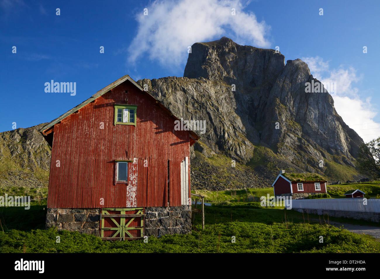 Traditional red wooden houses in norwegian village Nordland on island of Vaeroy, Lofoten - Stock Image