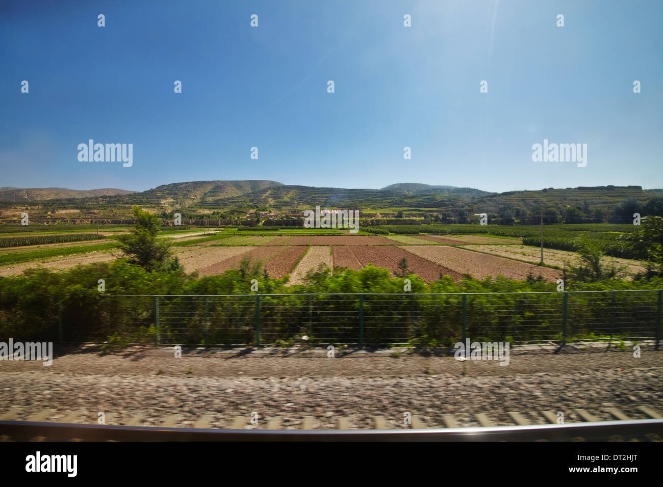 Outskirt view of China with farm and plantation on T22 Qinghai Tibet Train - Stock Image