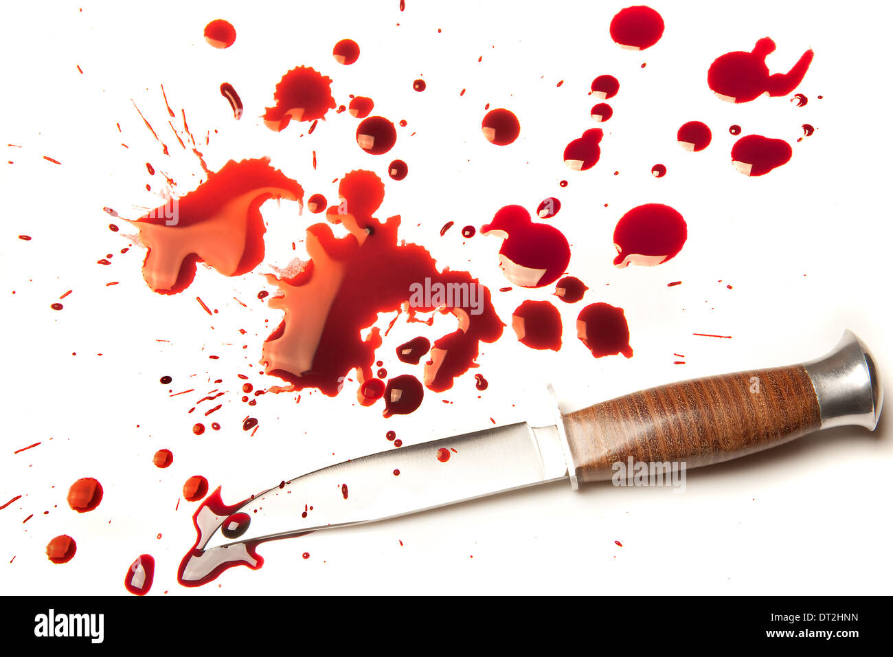 Isolated dagger with a splatter of red blood stains - Stock Image