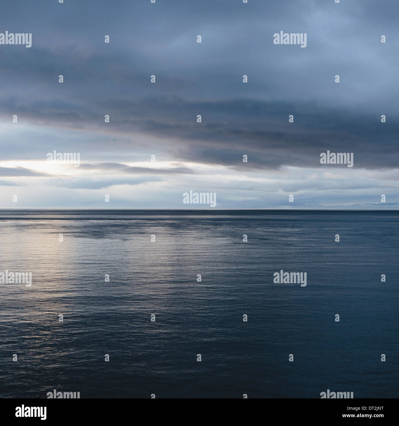 The sea and sky over Puget Sound in Washington USA The horizon with light cloud layers above - Stock Image
