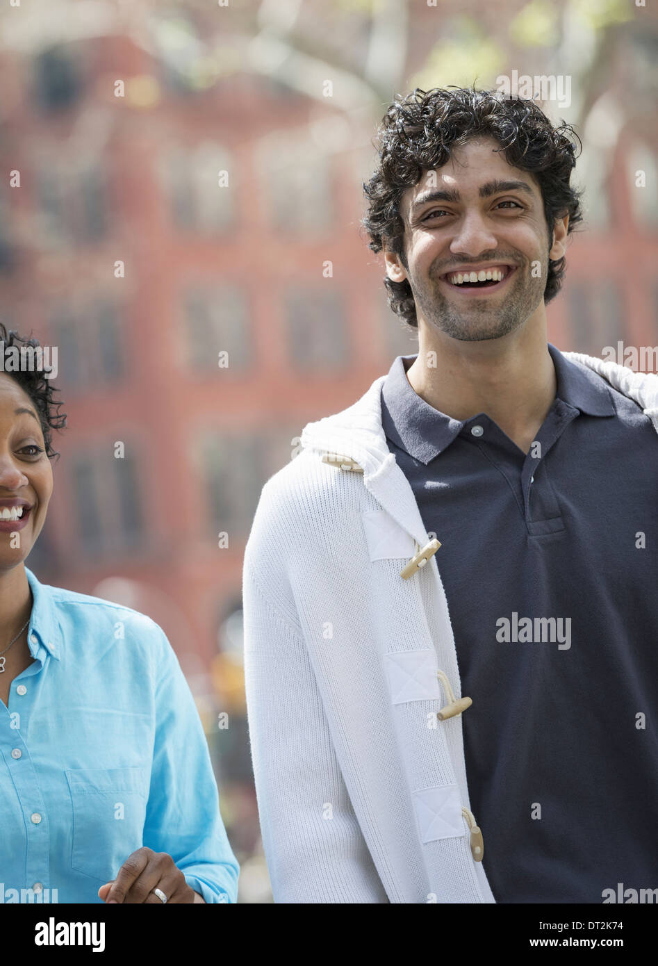 park A man and woman side by side smiling - Stock Image
