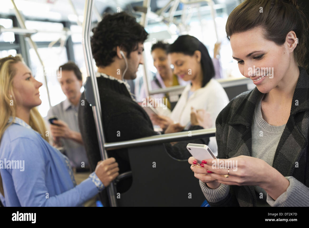 People men and women on a city bus - Stock Image