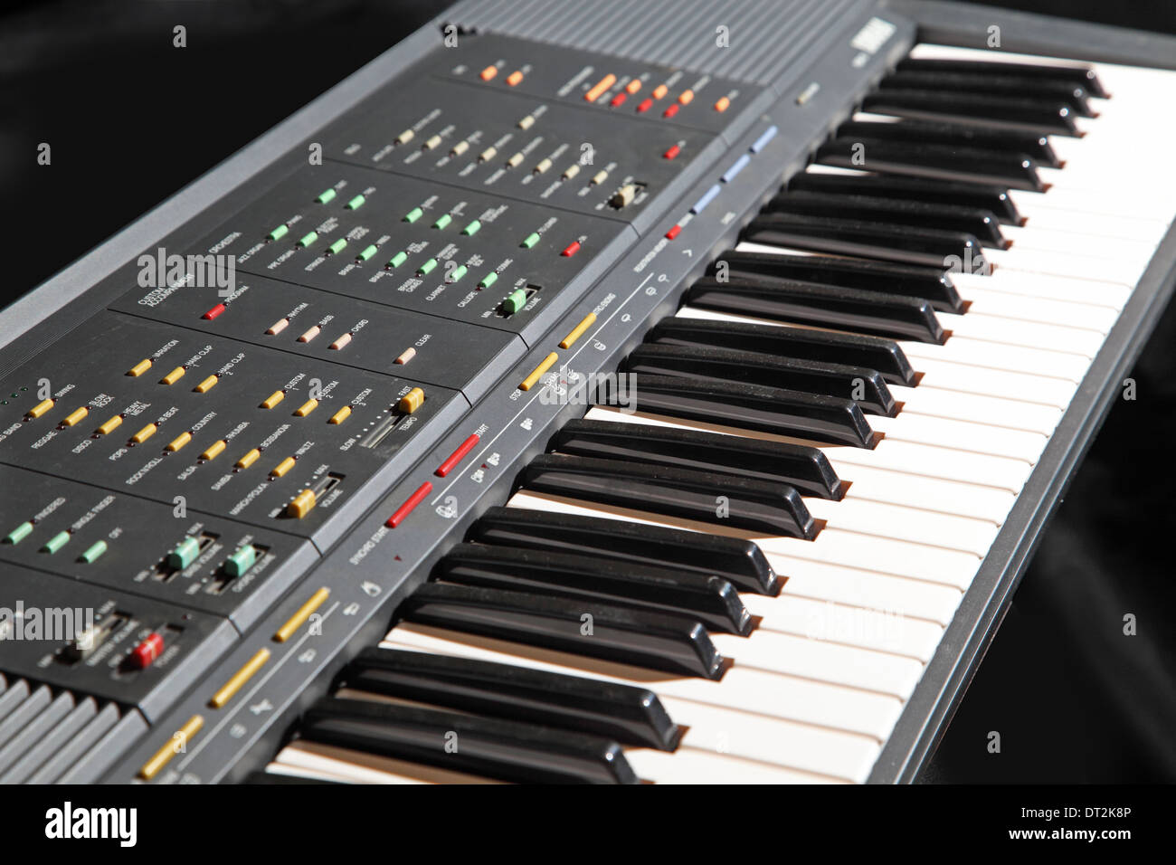 A Yamaha digital keyboard showing multiple buttons to control sounds, rhythms and automatic accompaniments - Stock Image