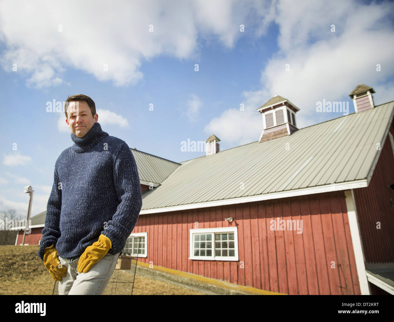 An Organic Farm in Winter in Cold Spring New York State A man working outdoors on the farm - Stock Image