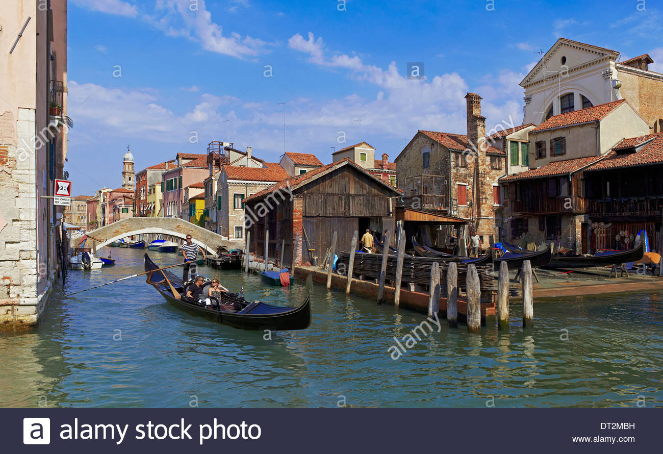 the gondola boatyard on the small channel rio san trovaso, venice, italy, europe - Stock Image