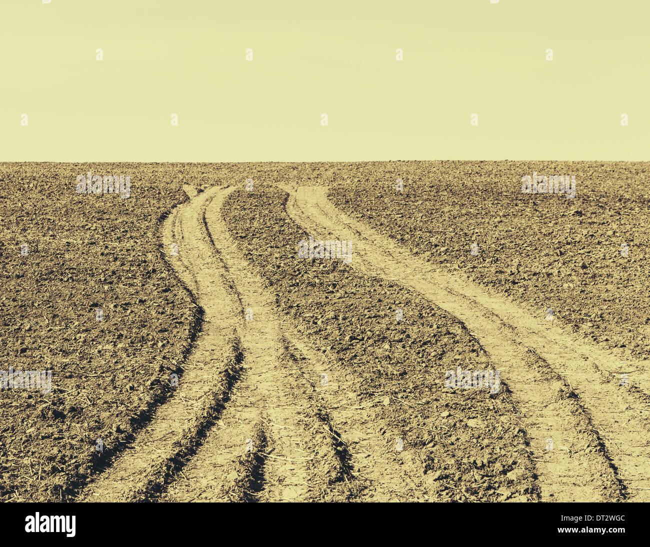 Fresh tire tracks on farmland near Pullman - Stock Image