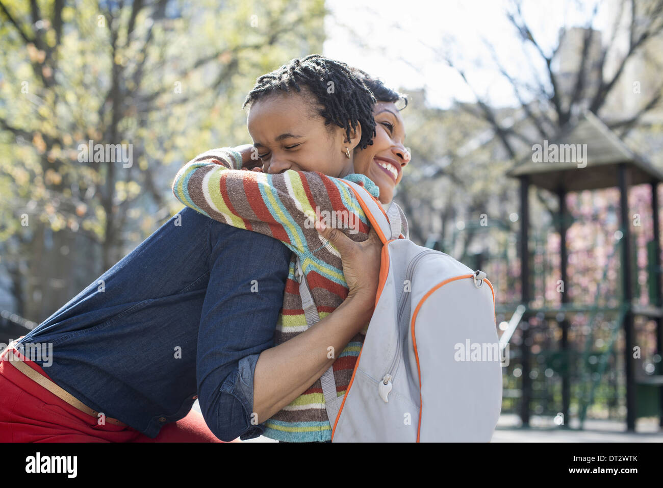 Sunshine and cherry blossom A mother and son spending time together - Stock Image