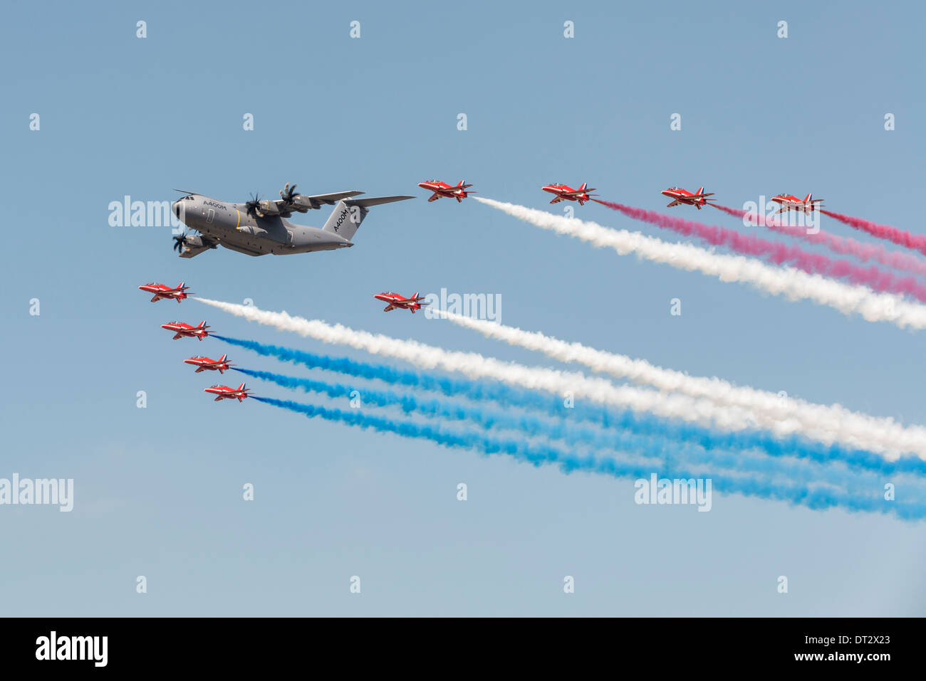 Airbus A400M Atlas, Europe's new turboprop powered military transport aircraft, flies in formation with the British Red Arrows - Stock Image