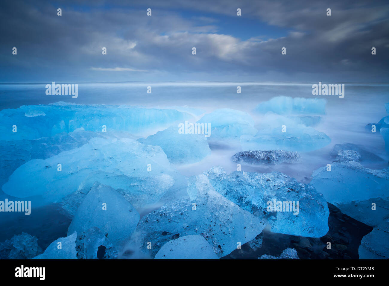 IceBergs and waves on Jokulsarlon Beach, Polar region, South Iceland - Stock Image