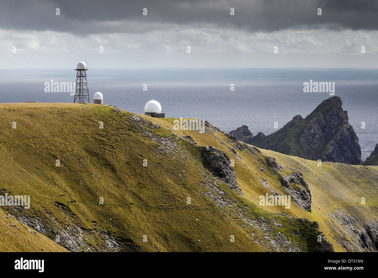 Radar towers on Hirta, St Kilda with the cliffs on Dun visible in the background - Stock Image