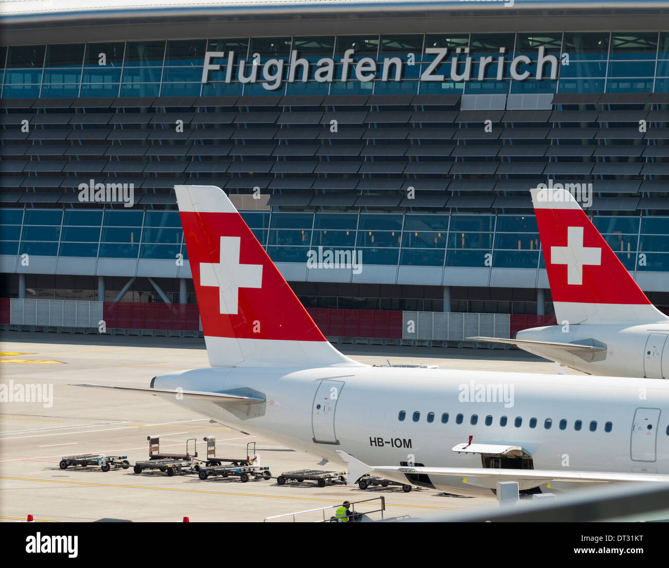 Swiss International Airlines passenger aircrafts parked at Zurich Kloten International Airport Terminal Two - Stock Image