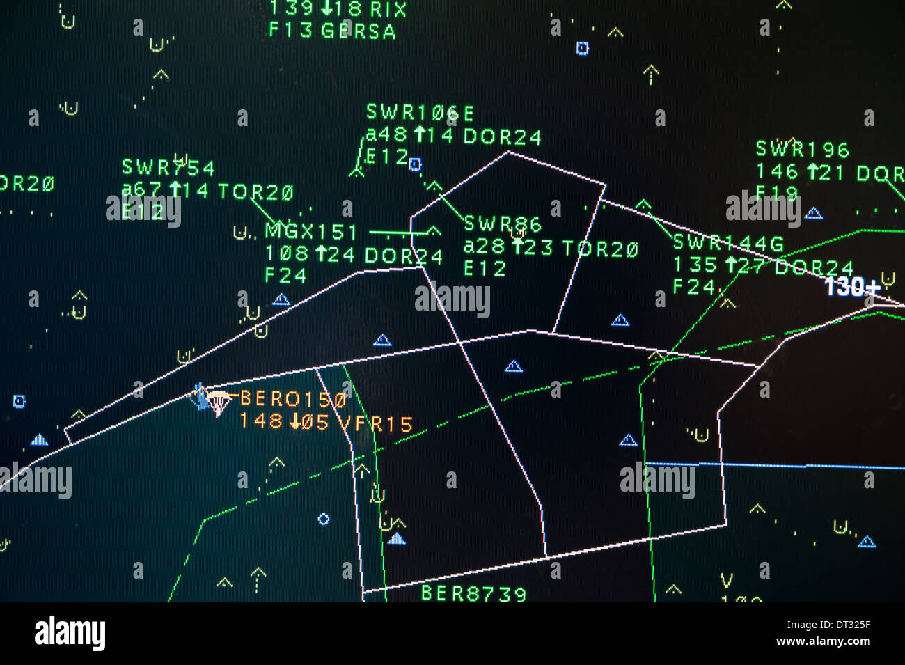 Computer monitors in the air traffic control centre of 'Skyguide' show flight paths of aircrafts in Switzerland's busy airspace - Stock Image