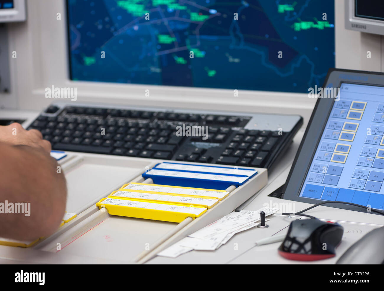 The desk of an air traffic controller in an air traffic control centre - Stock Image