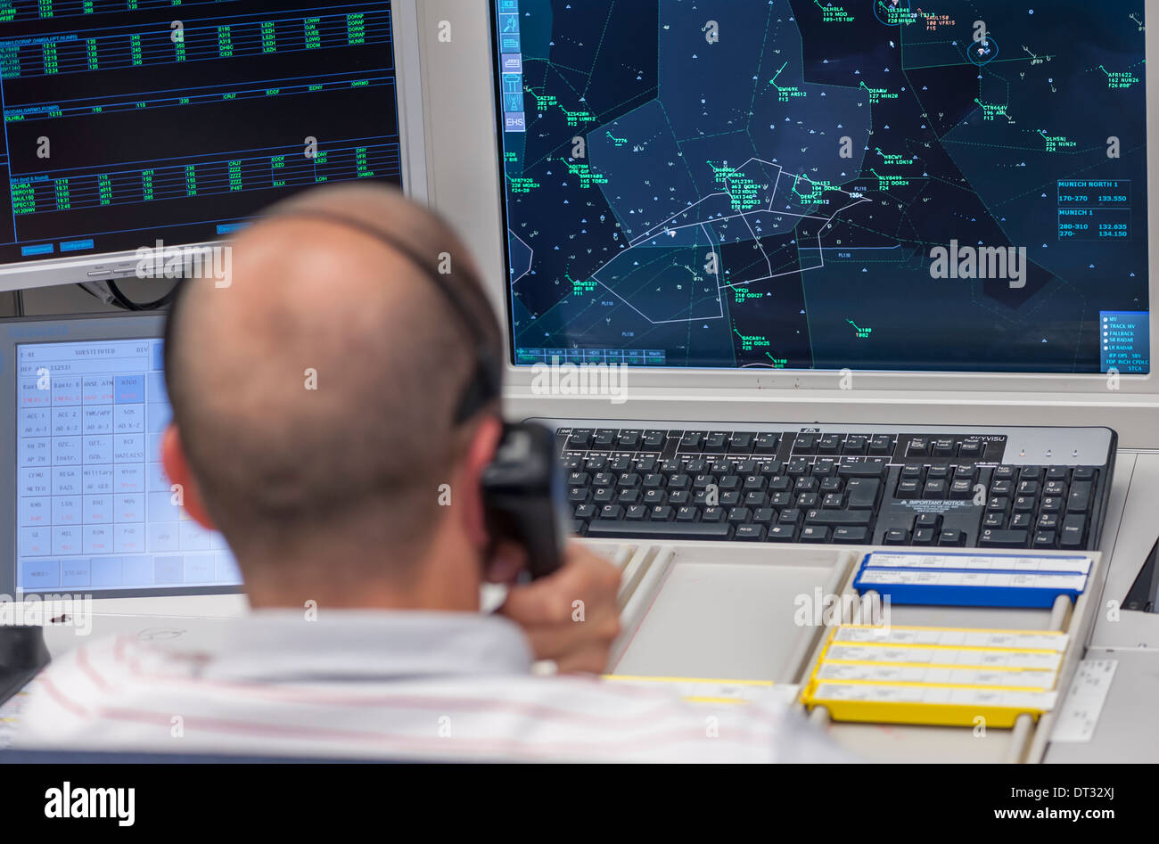 """An air traffic controller in the air traffic control centre of """"Skyguide"""" is navigating aircrafts through Switzerland's Stock Photo"""