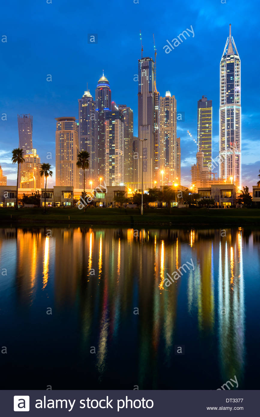 Night skyline of high-rise apartment and office towers in new Dubai Marina district in United Arab Emirates - Stock Image
