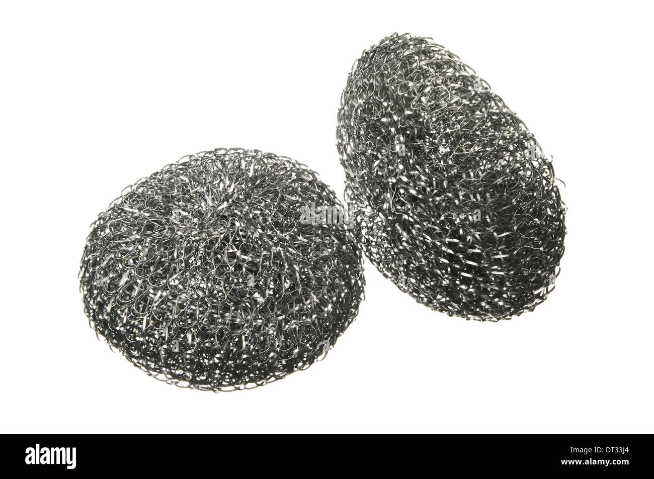 Two metal sponge for ware washing isolated on a white background - Stock Image