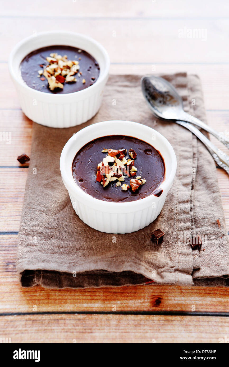 chocolate pudding with nuts, food closeup - Stock Image