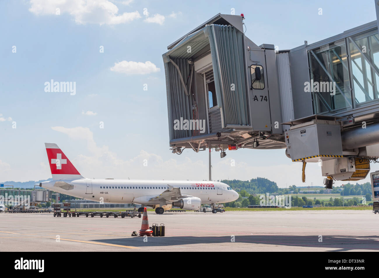 An Airbus aircraft of Swiss International Airlines is pulled to the runway at Zurich international airport - Stock Image