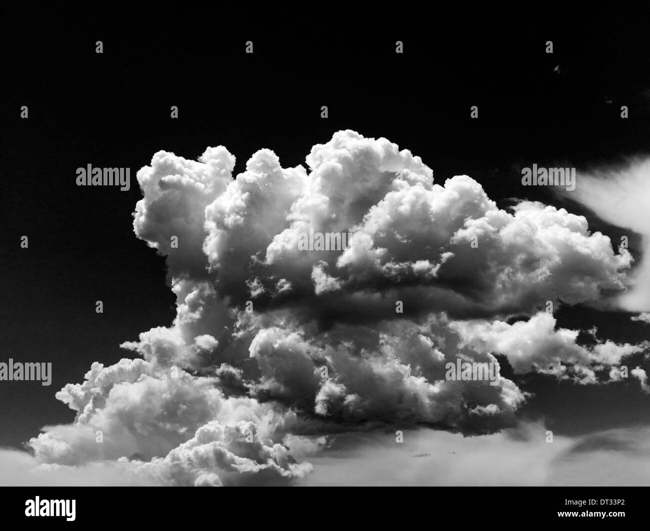 Black white view of white puffy cumulus clouds against clear colorado sky