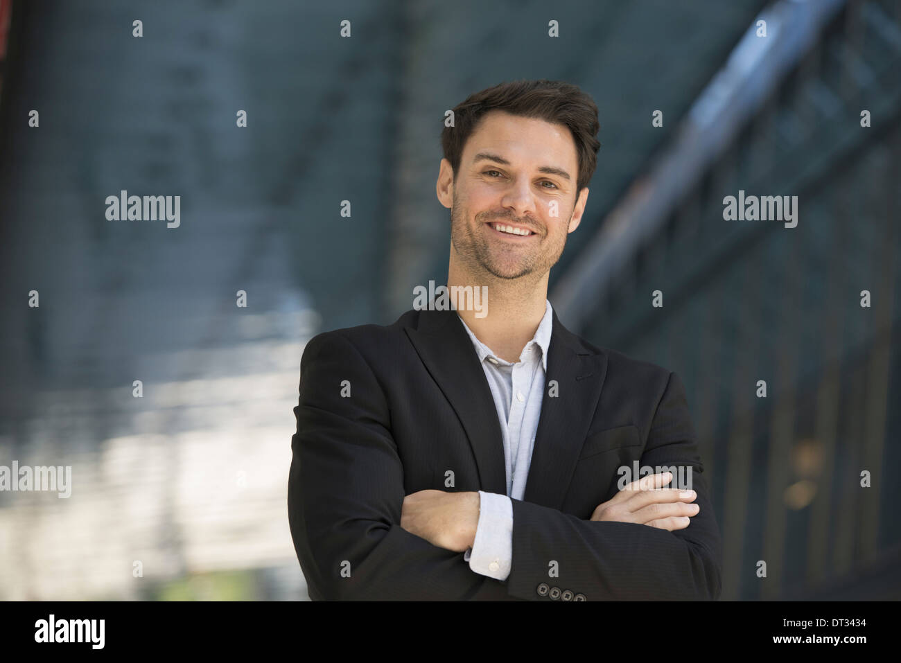 A man in a black jacket and open collared shirt Stock Photo