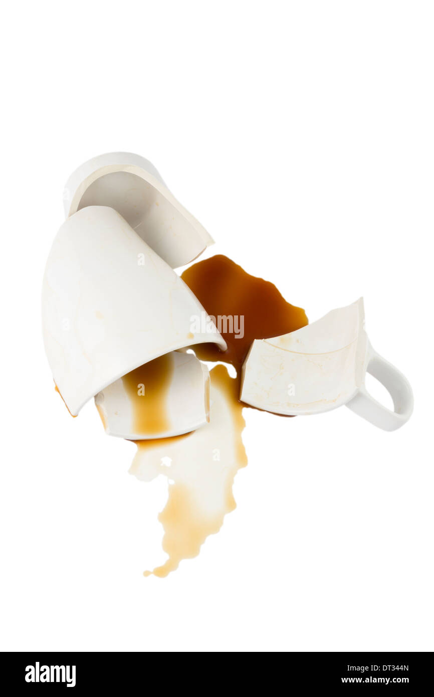 Broken cup of coffee isolated on white background - Stock Image