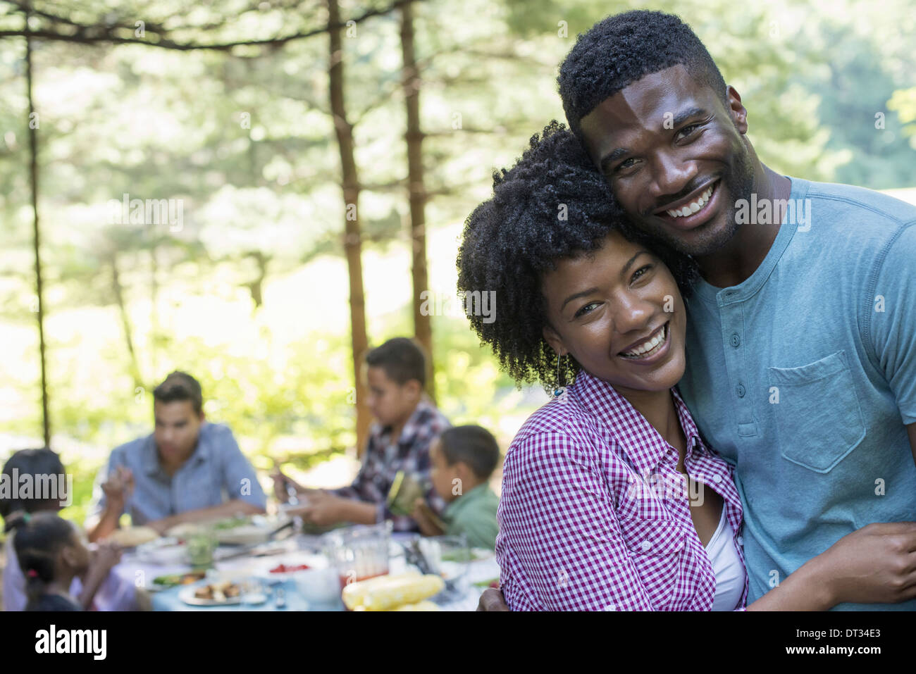A couple hugging each other - Stock Image