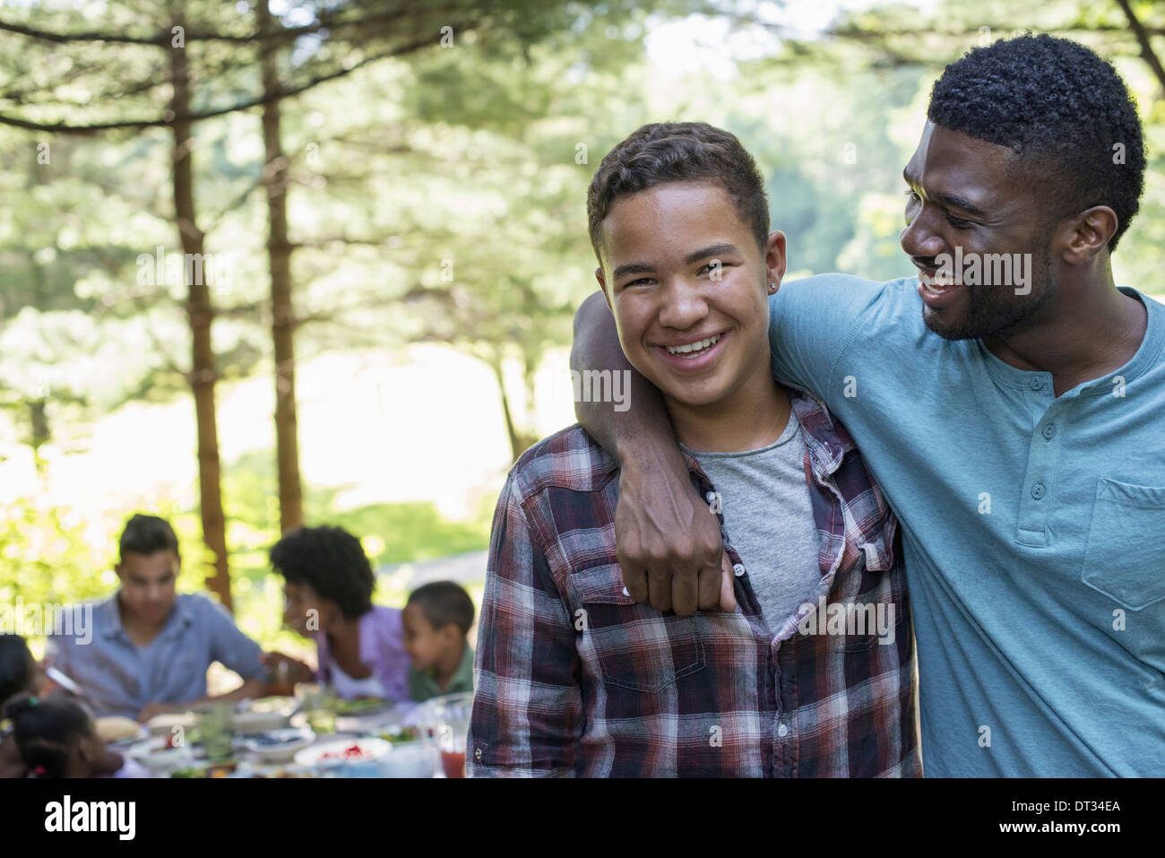 A man and a young boy looking at the camera - Stock Image