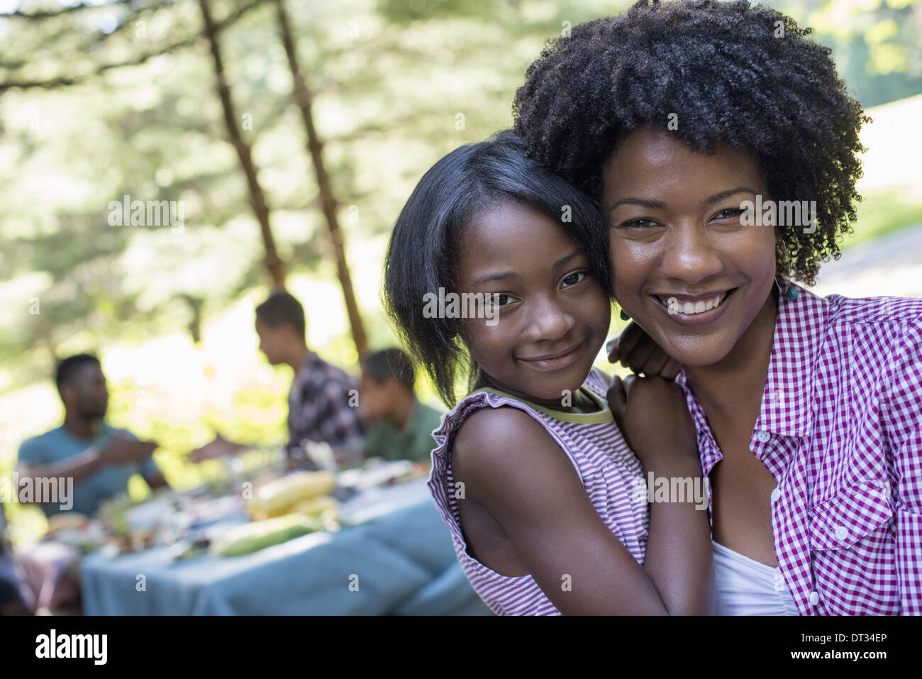 A young girl and adults seated at the table - Stock Image