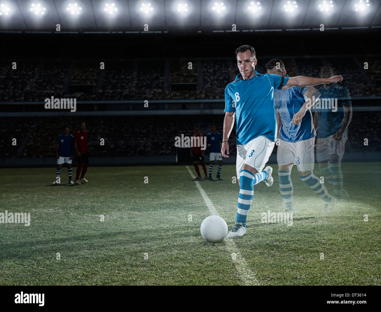 Soccer player approaching ball on field - Stock Image