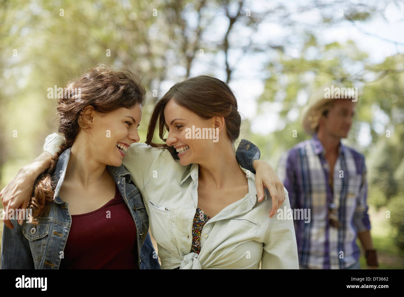 Two friends smiling at each other - Stock Image