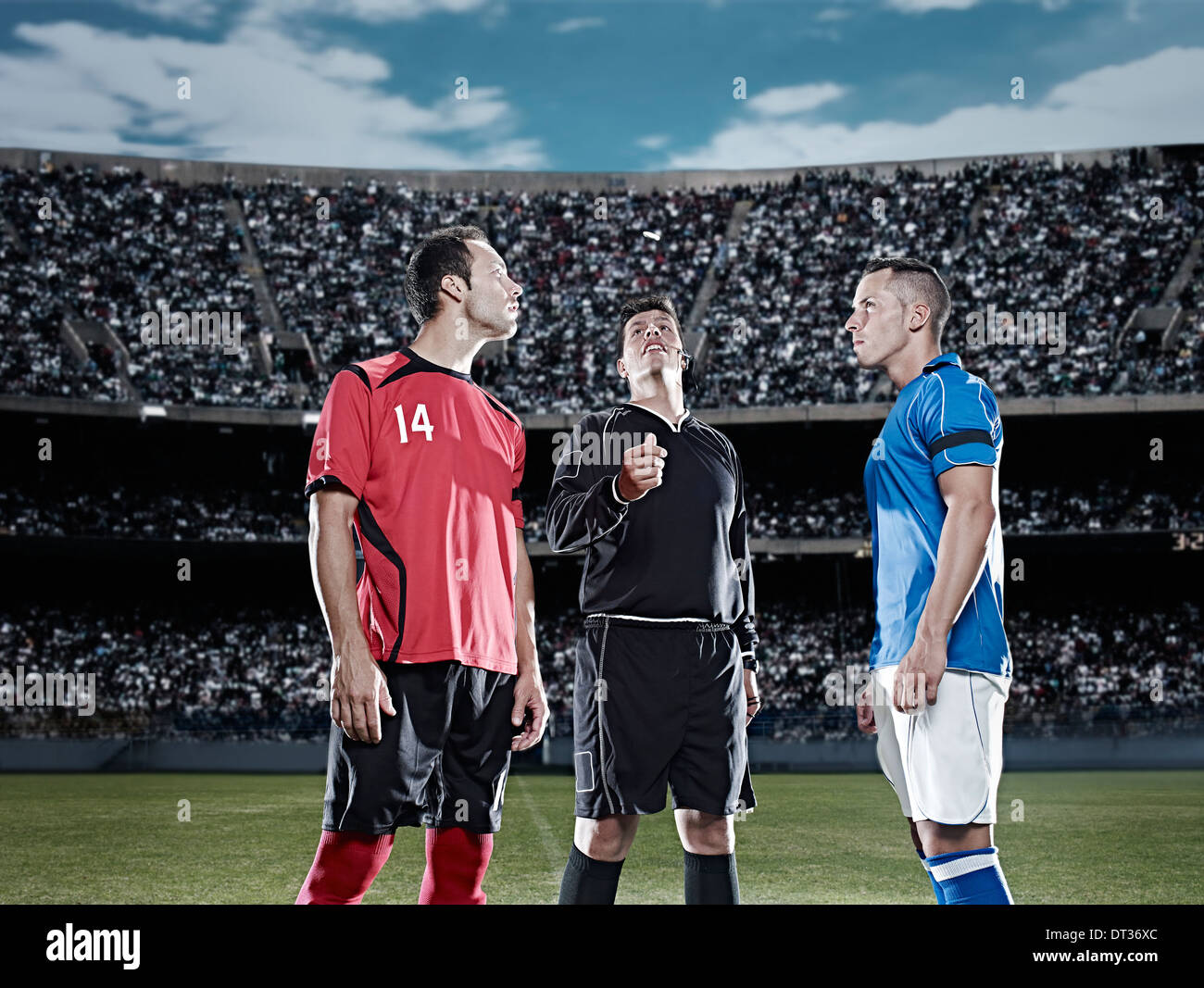 Referee tossing coin in soccer game - Stock Image