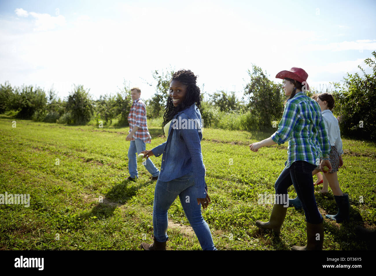 A group of young men and women in the fields of an organic farm - Stock Image