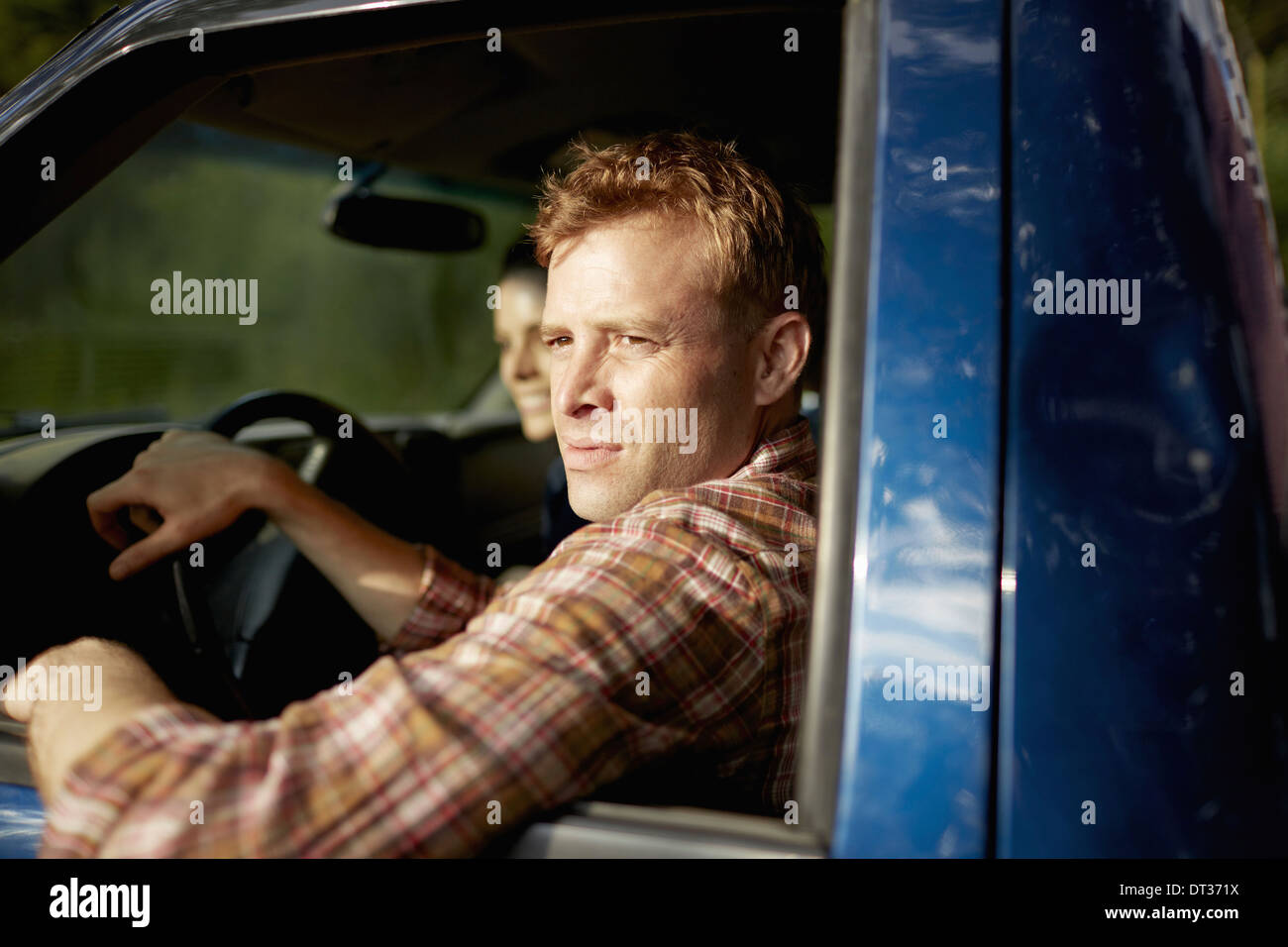 A pick up truck driver with woman beside him - Stock Image