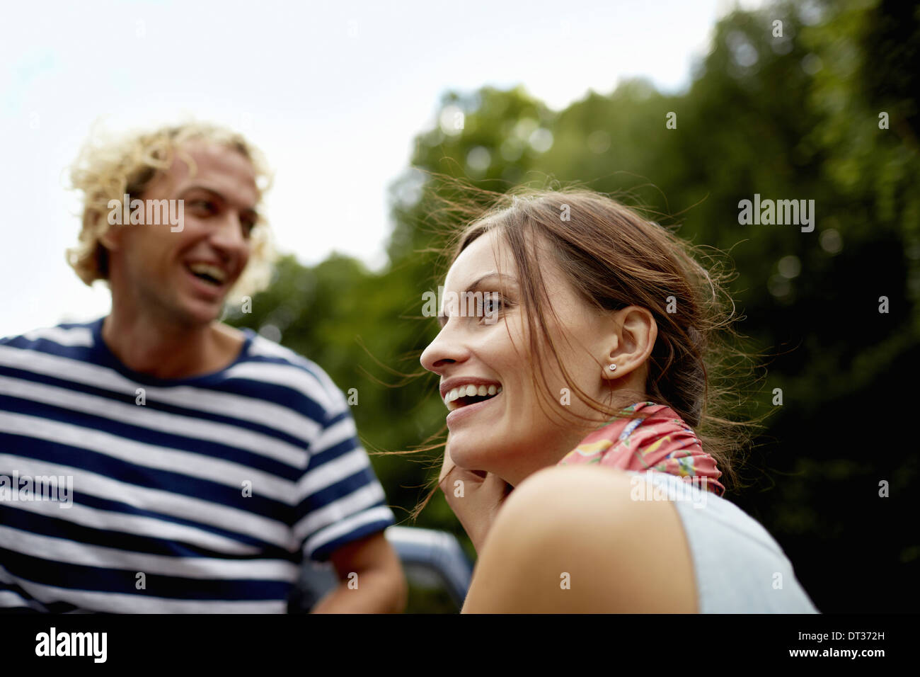 couple young man and woman in woodland - Stock Image