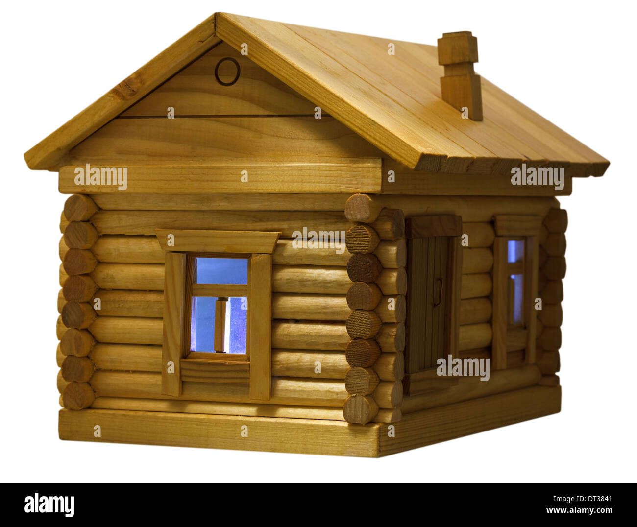 blue light in window of model of village wooden log house in evening isolated on white background - Stock Image