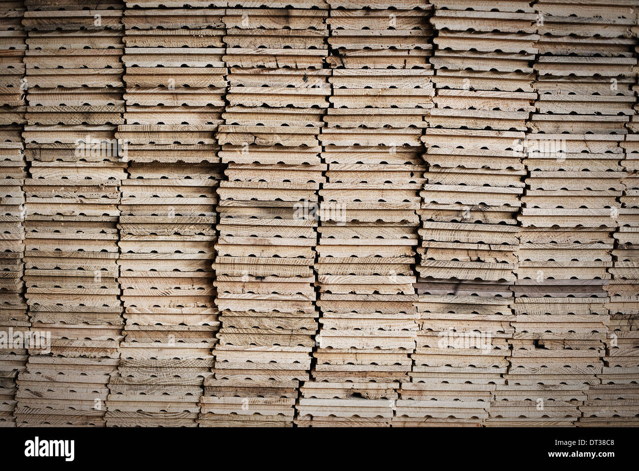 A reclaimed lumber workshop. Stacks of reclaimed, cleaned up planks of wood for re-use. - Stock Image